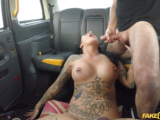 This tattooed girl is in for a sexual treat on her way house